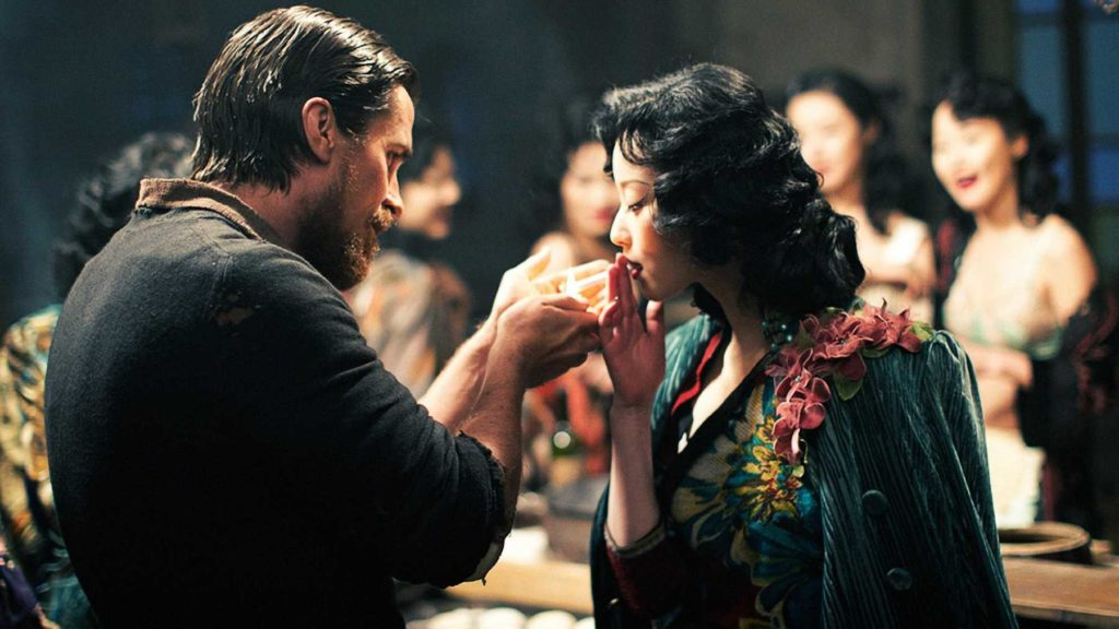 flowers of war screenshot with christian bale and ni ni sharing a cigarette