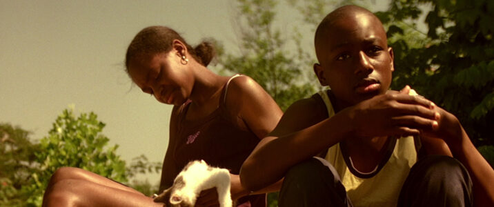 Nasia (Candace Evanofski) and George (Donald Holden) hanging out by the creek on a hot summer day in David Gordon Green's