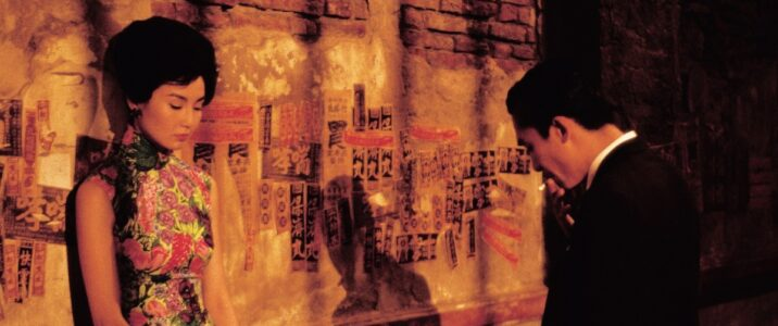 Mrs. Chan (Maggie Cheung) & Mr. Chow (Tony Leung)  start having feelings for each other after realizing their spouses are having an affair in Wong Kar-Wai's masterpiece