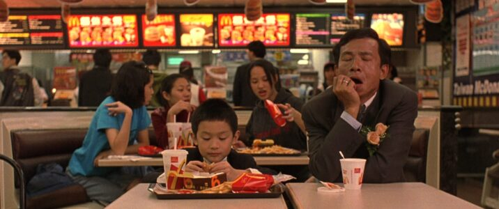 JD (Nien-Jen Wu) treats his son Yang Yang (Jonathan Chang) to a McDonald's meal in Edward Yang's