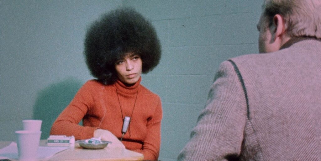 "A still image from the 2011 documentary ""Black Power Mixtape: 1967-1975"", featuring activist Angela Davis being interviews by a Swedish filmmaker"