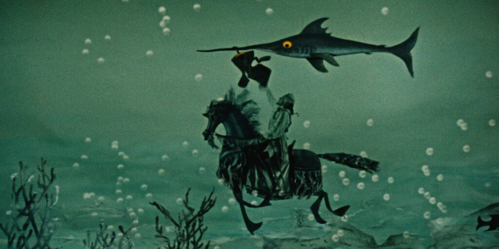 """A still image from the 1962 Karel Zeman film """"The Fabulous Baron Munchausen"""", featuring the titular baron grappling with a large swordfish while riding a horse"""