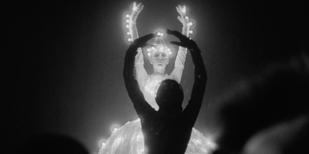 """A still image from the 1989 film """"My Twentieth Century"""", featuring two dancers performing onstage"""