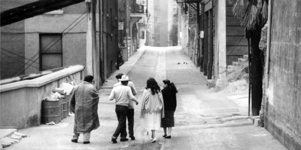 """The closing shot of the 1961 film """"The Exiles"""", of a group clustered together in the Bunker Hill neighborhood of Los Angeles"""