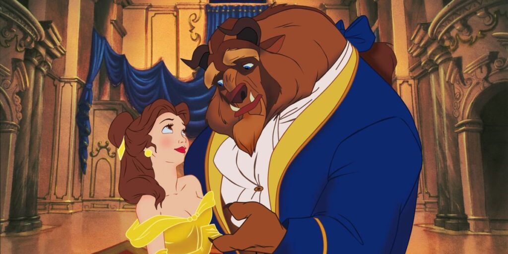 """A screenshot from the 1991 Walt Disney Animation film """"Beauty and the Beast"""" featuring Belle and the Beast clasping hands together in the grand hall"""
